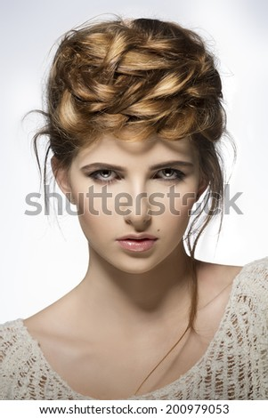 close-up shoot of pretty young girl with perfect skin, natural make-up and creative elegant hair-style  - stock photo