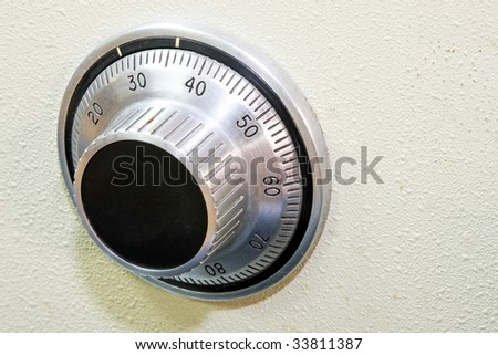 Close up shot classic combination lock dial - stock photo