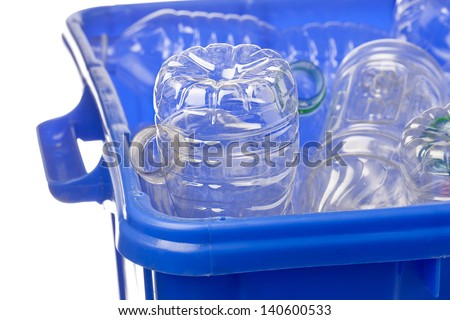 Close-up shot of a blue recycle bin with plastic bottles for recycling. - stock photo