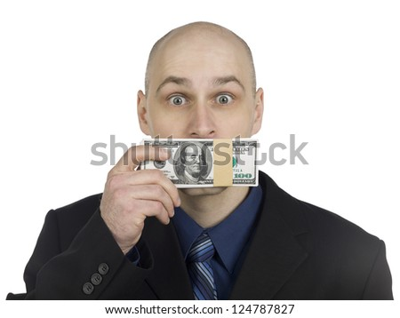 Close-up shot of a businessman covering his mouth with money bundle. - stock photo