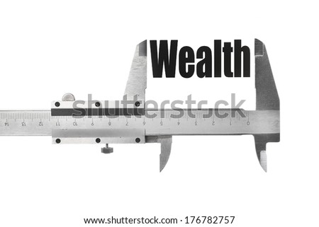 """Close up shot of a caliper measuring the word """"Wealth"""" - stock photo"""