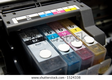 close-up shot of a CMYK ink cartridges for a color printer shallow depth of field - stock photo