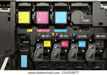 close-up shot of a CMYK ink cartridges for laser copier machine - stock photo