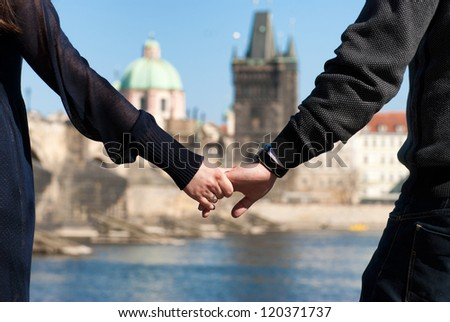Close up shot of a couple holding hands - stock photo