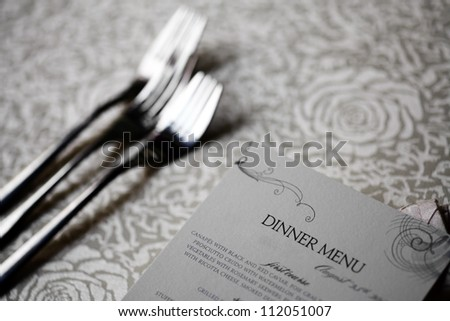 Close up shot of a dinner menu on a table - stock photo