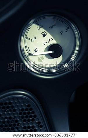 Close up shot of a fuel gauge. - stock photo
