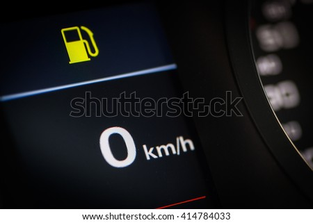 Close-up shot of a fuel pump icon in a car. - stock photo