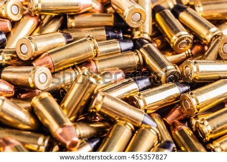 close up shot of a heap of 9x21 pistol bullets - stock photo