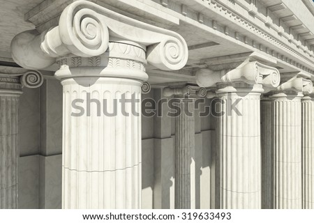 Close-up shot of a line of Greek-style columns. - stock photo
