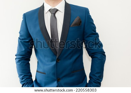 Close-up shot of a man dressed in formal wear .Groom's suit - stock photo