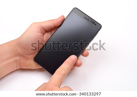 Close up shot of a man holding a modern smartphone and pointing with finger. Blank screen - stock photo