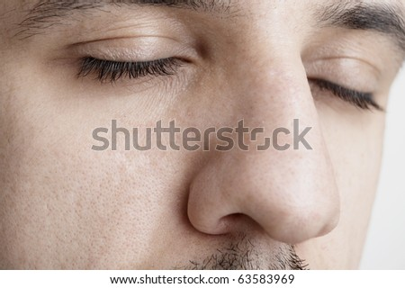 Close-up shot of a part of man's face. Isolated on white background - stock photo