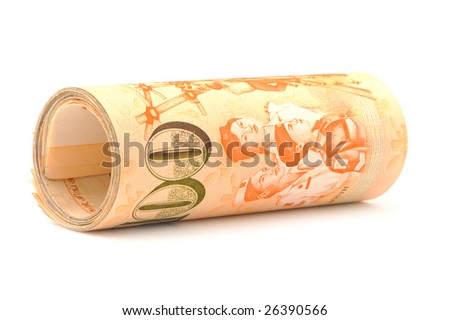 close up shot of a roll of singapore dollar notes - stock photo