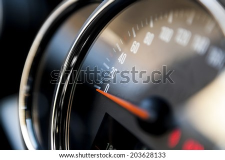 Close up shot of a speedometer in a car - stock photo