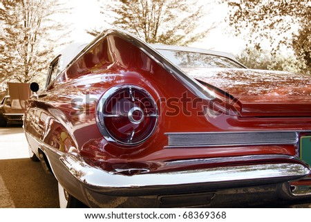 Close up shot of a vintage car in sepia color tone - stock photo