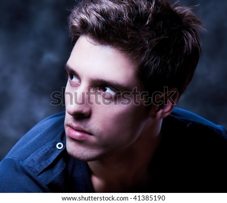 Close up  Shot of a Young Man. A trendy European man dressed in contemporary cloth. He is now a professional model. - stock photo