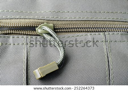 Close up shot of a zipper on a military bag pocket - stock photo