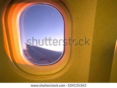 close up shot of airplane window view - stock photo