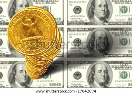 close up shot of  American quarter dollars over 100 dollar bills - stock photo