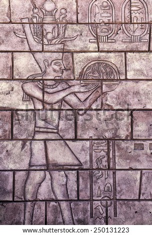 Close-up shot of an Egyptian carving on a wall in Cairo, Egypt, Africa. - stock photo