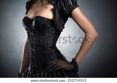 Close-up shot of an elegant woman in Victorian style corset, studio shot  - stock photo