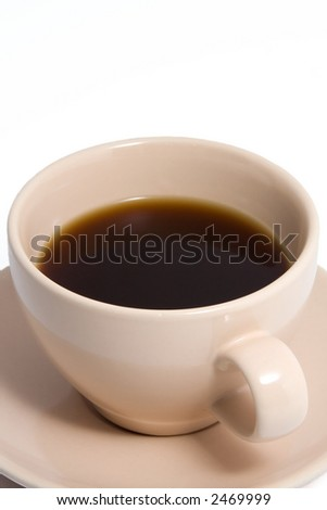 Close up shot of an peach colored coffee cup and saucer, containing black coffee. - stock photo