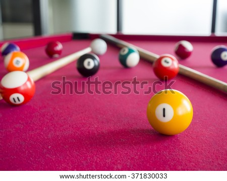 close up shot of 1 Ball from pool or billiards on a billiard table. Selective Focus. - stock photo