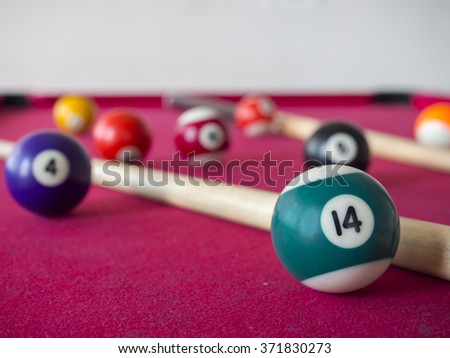 close up shot of 14 Ball from pool or billiards on a billiard table. Selective Focus.Billiard balls on the table. - stock photo