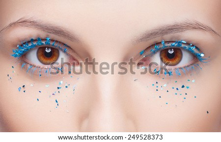 Close-up shot of beautiful female eyes with bright fashion makeup - stock photo