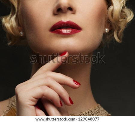 Close-up shot of beautiful woman face with red lips - stock photo