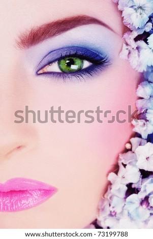 Close-up shot of beautiful woman's face with bright makeup - stock photo