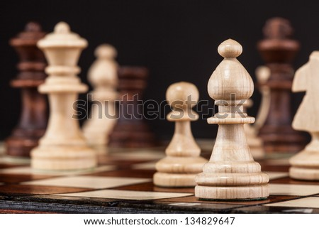 Close-up Shot Of Chess Board And Figures - stock photo