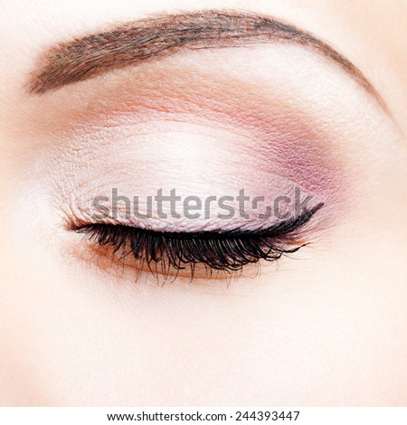 Close-up shot of closed female eye makeup - stock photo
