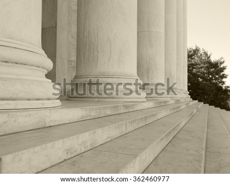 Close up shot of columns and steps in black and white soft tint filter. - stock photo