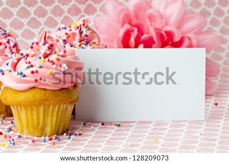 Close-up shot of cupcakes with placard. - stock photo