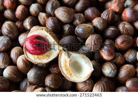 Close up shot of cut open nutmeg with red seed inside - stock photo