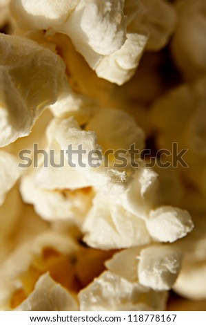 Close-up shot of delicious freshly popped popcorn - stock photo