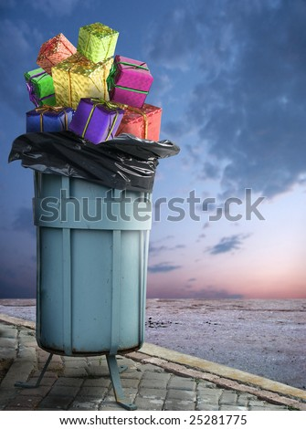 close up shot of dirty dumpster and several giftboxes in it - stock photo