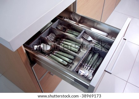 close up shot of drawer with spoons and forks - stock photo