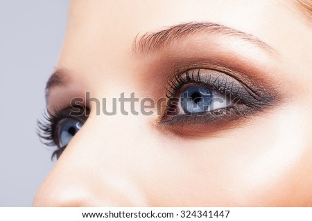 Close-up shot of female eyes make-up in smoky eyes style - stock photo