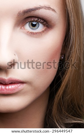 Close-up shot of female face makeup - stock photo