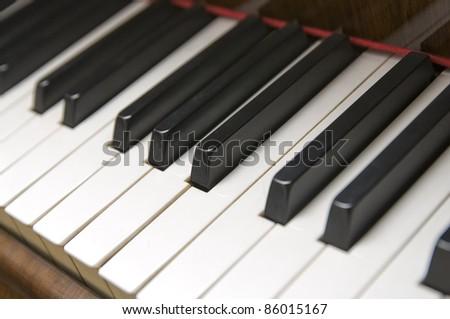 Close up shot of grand piano keys - stock photo