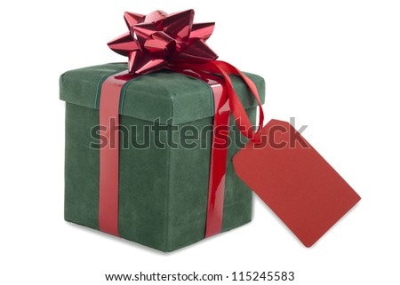 Close-up shot of green gift box tied with bow with red empty placard. - stock photo