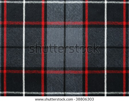 Close up shot of grey wool plaid/tartan with red and white stripes. - stock photo