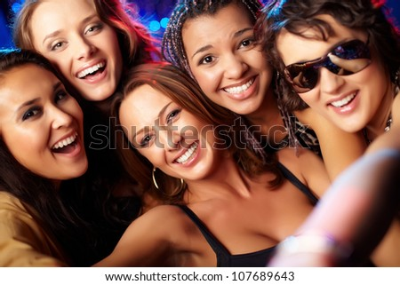 Close-up shot of group of laughing girls having party - stock photo