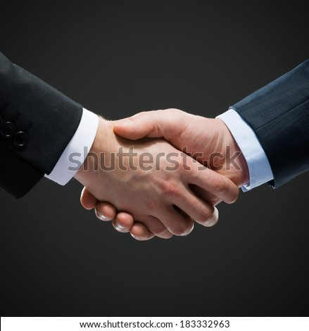 Close up shot of hand shake of business people. Concept of trustworthy relations and business cooperation - stock photo
