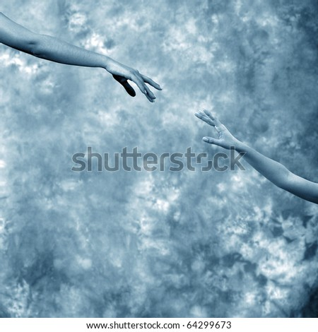 close up shot of hands reaching each other - stock photo
