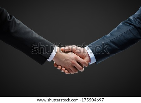 Close up shot of handshake of business people. Concept of trustworthy relations and business cooperation - stock photo