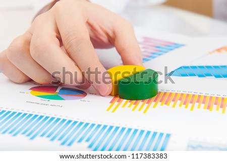 Close up shot of mans hand with puzzle diagram - stock photo