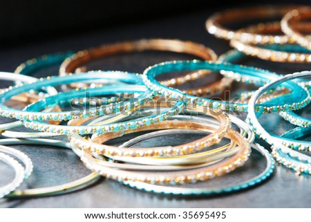 Close up shot of many indian style bangle bracelets - stock photo